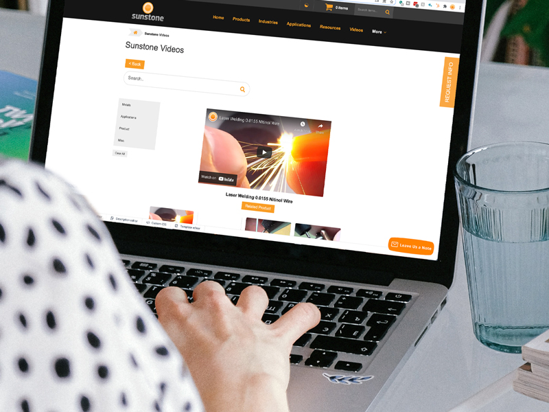person looking at videos page on sunstone welders website